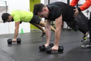 Flexiones de pesas en QBOX